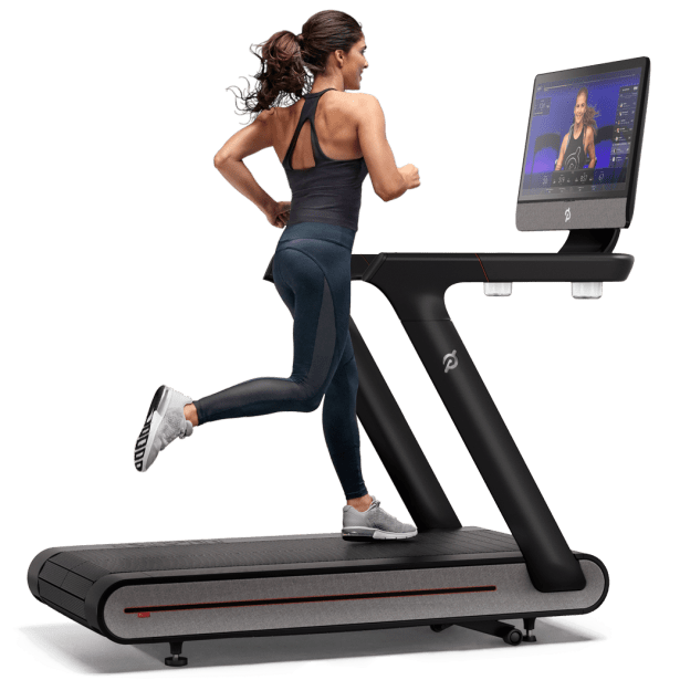 Peloton Tread Review - Woman Running on Machine